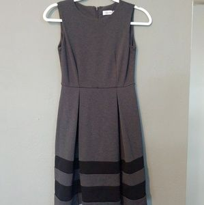 A frame grey and black dress.